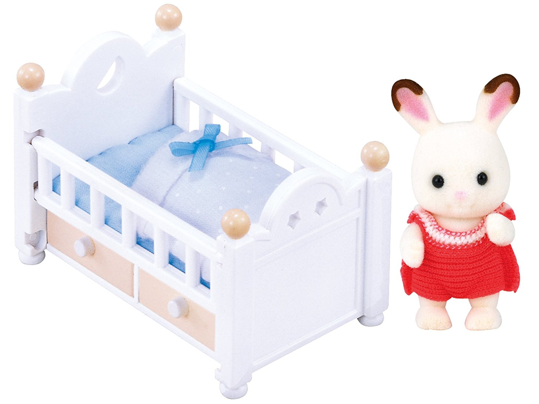 Baby mit Babybett